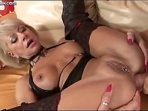 A kinky blond Milf gets fucked apart from a obese dick