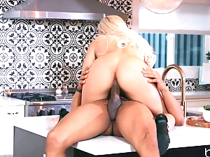 Low-spirited blonde anally rides lover's BBC in a catch kitchen