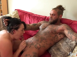 Big-assed MILF blows and rides inked younger hunk